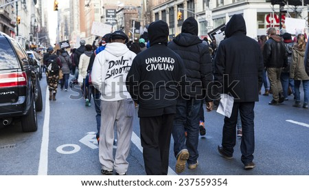 New York, NY USA - December 13, 2014: Protesters march against police brutality and grand jury decision on Eric Garner case on 6th Avenue