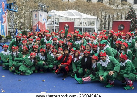 New York, NY, USA - December 2, 2014: Rosario Dawson kicks off Operation 'Give With Gusto' in New York with NESCAFE Dolce Gusto and 100 Holiday Elves at Bryant Park, Manhattan - stock photo