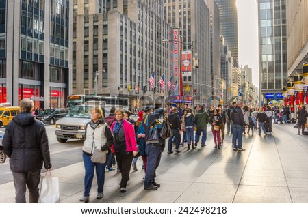 New York, NY, USA - December 27, 2014: Sixth Avenue in Midtown Manhattan packed with Locals and Tourists during the Christmas Holidays. More than 50 million people visit New York every year.