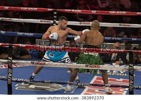 New York, NY USA - Feb 27, 2016: Sean Monaghan (white trunks) celebrates victory against Janne Forsman of Finland in professional boxing match in Light Heavyweight category at Madison Square Garden - stock photo