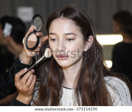 New York, NY, USA - February 3, 2016: A model prepares backstage for Cadet Fall/Wnter 2016 Collection Men + Women presentation during NY Fashion Week Men's at Skylight Clarkson North, Manhattan - stock photo