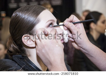 New York, NY, USA - February 16, 2015: A model prepares backstage for Dennis Basso Fall 2015 Runway show during Mercedes-Benz Fashion Week New York at the Theatre at Lincoln Center, Manhattan - stock photo