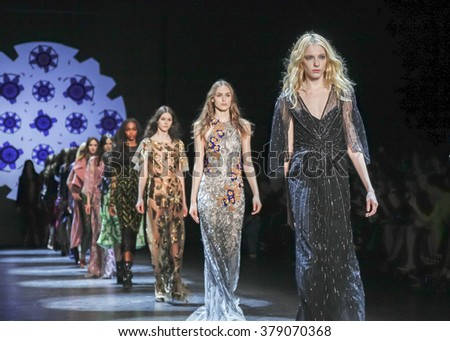 New York, NY, USA - February 13, 2016: A model walks runway at the Monique Lhuillier runway show during of Fall/Winter 2016 New York Fashion Week at The Arc, Skylight at Moynihan Station, Manhattan. - stock photo