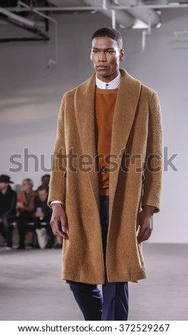 New York, NY, USA - February 2, 2016: A model walks runway for Carlos Campos Fall/Winter 2016 runway show during NY Fashion Week Men's at Skylight Clarkson North, Manhattan