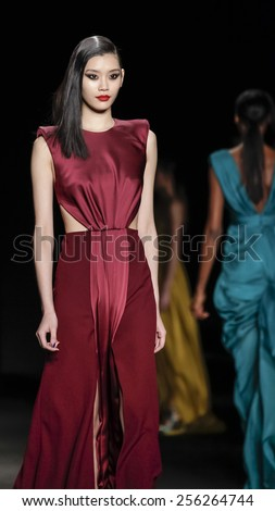 New York, NY, USA - February 13, 2015: A model walks runway for Monique Lhuillier Fall 2015 Runway show during Mercedes-Benz Fashion Week New York at the Theatre at Lincoln Center, Manhattan - stock photo