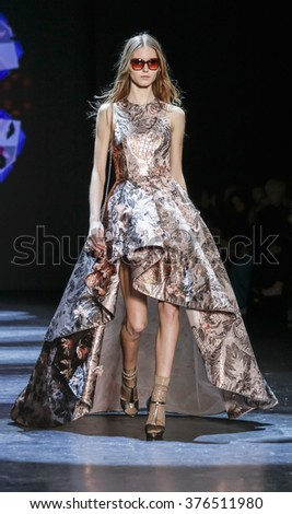 New York, NY, USA - February 13, 2016: A model walks the runway at Monique Lhuillier runway show during of Fall/Winter 2016 New York Fashion Week at The Arc, Skylight at Moynihan Station, Manhattan. - stock photo
