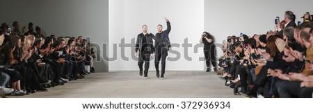 New York, NY, USA - February 2, 2016: Designers Shimon Ovadia (L) and Ariel Ovadia walk the runway for Ovadia & Sons Fall2016 runway show during NY Fashion Week Men's at Skylight Clarkson North - stock photo