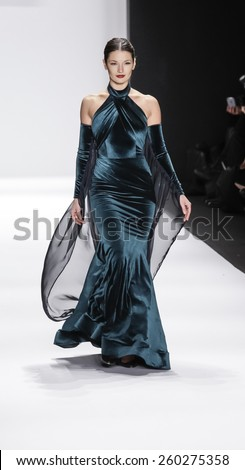New York, NY, USA - February 19, 2015: Model walks runway for Walter Mendez Fall 2015 collection at Art Hearts Fashion Presented By AIDS HF fashion show during MBFW at The Theatre at Lincoln Center - stock photo