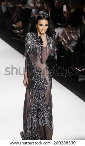 New York, NY, USA - February 19, 2015 model walks runway for Walter Mendez Fall 2015 collection at the Art Hearts Fashion Presented By AIDS HF during MBFW at The Theatre at Lincoln Center - stock photo