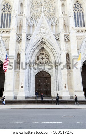 NEW YORK, NY, USA - February 25, 2015: St. Patrick's Cathedral is a Roman Catholic Church, American landmark and tourist destination located on Fifth Avenue in Manhattan. - stock photo