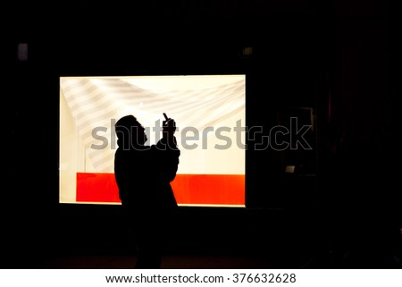 New York, NY, USA- January 8, 2016: A man with cell phone: A man taking picture with cell phone.
