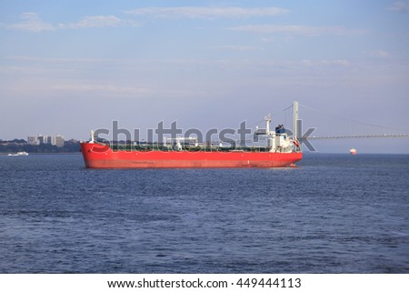 New York, NY, USA - January 24, 2016: Big industrial tanker ship goes on New York Bay.