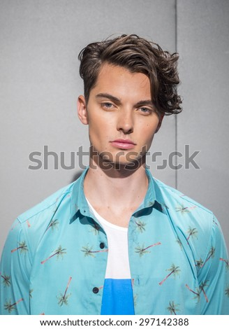 New York, NY, USA - July 16, 2015: A model poses at the Roicardo Seco 'Luck' collection presentation during New York Fashion Week: Men's S/S 2016 at Skylight Clarkson Sq, Manhattan - stock photo