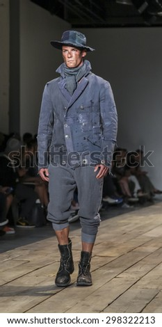 New York, NY, USA - July 15, 2015: A model walks runway at the Greg Lauren Runway show during New York Fashion Week: Men's S/S 2016 at Skylight Clarkson Sq, Manhattan