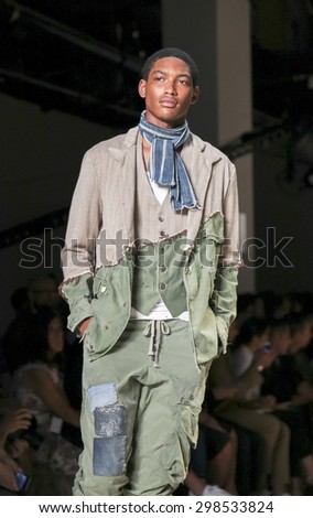 New York, NY, USA - July 15, 2015: A model walks runway at the Greg Lauren Runway show during New York Fashion Week: Men's S/S 2016 at Skylight Clarkson Sq, Manhattan - stock photo