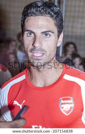 New York, NY, USA - July 25, 2014: Arsenal player Mikel Arteta attends the PUMA partners with Arsenal Football Club to Debut Monumental Cannon event in Grand Central Station in New York City. - stock photo