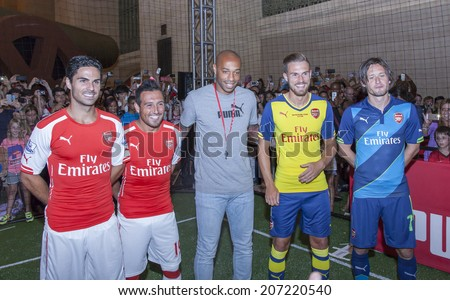 New York, NY, USA - July 25, 2014: (L-R) Santi Cazorla, Mikel Arteta, Thierry Henry, Aaron Ramsey and Tomas Rosicky greet fans at PUMA partners w/Arsenal to Debut Monumental Cannon event in GCS in NYC - stock photo