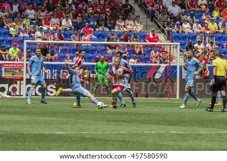 New York, NY USA - July 24, 2016: Mike Grella (13) of New York Red Bulls controls ball during MLS game against NYC FC at Red Bull arena. Red Bulls won 4 - 1