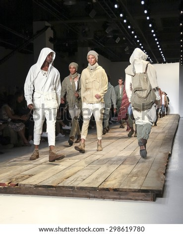 New York, NY, USA - July 15, 2015: Models walk runway at the Greg Lauren Runway show during New York Fashion Week: Men's S/S 2016 at Skylight Clarkson Sq, Manhattan - stock photo