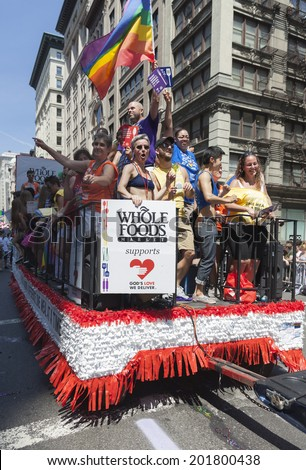 New York, NY USA - June 29, 2014: Atmosphere during annual 44th Pride Parade on Fifth Avenue with sponsor Whole Foods in Manhattan - stock photo