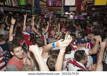 New York, NY USA - JUNE 26: Fans of the United States Men's National Soccer Team celebrate after United States advanced to second round of World Cup inside Legends sport Bar