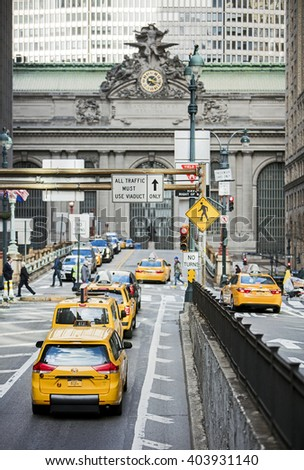 NEW YORK, NY, USA - MAR 17, 2016: Yellow taxi cabs on Park Avenue going to Grand Central Terminal. - stock photo