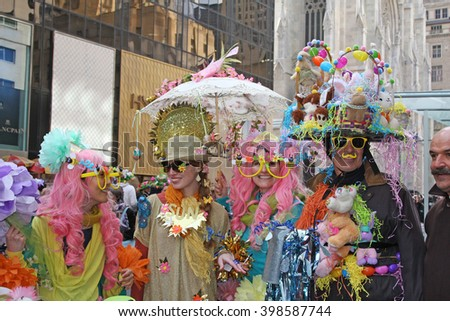 New York, NY USA- March 27, 2016: Participants in costume pose as a group for spectators during the Easter Bonnet Parade in New York City.  - stock photo