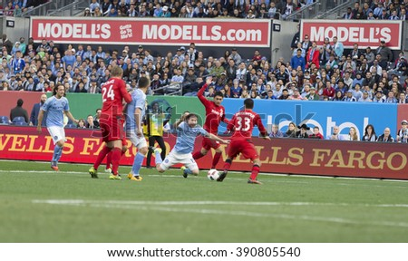 New York, NY USA - March 13, 2016: Players of Toronto FC and New York FC fighting for the ball in Toronto FC penalty box during game on Yankee stadium - stock photo