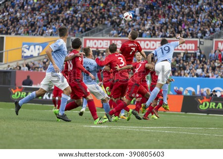 New York, NY USA - March 13, 2016: Players of Toronto FC and New York FC fighting for the ball in Toronto FC penalty box during game on Yankee stadium