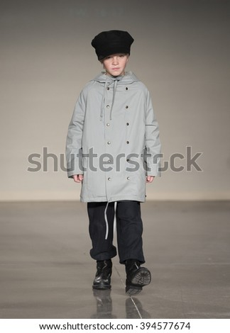 New York, NY USA - March 12, 2016: Young model walks runway for Little Creative Factory by Cristina Fernandez during petiteParade fashion show at Spring studios