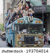 New York, NY, USA - May 17, 2014: Blue Bird bus with Blue  Byrds dance group drive at The 8th Annual New York City Dance Parade and Festival - stock photo