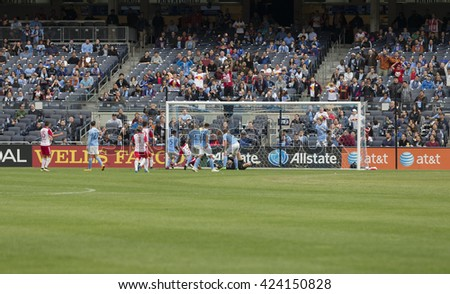 New York, NY USA - May 21, 2016: Gideon Baah (3) scores 7th goal at MLS game NYC FC against Red Bulls at Yankee stadium - stock photo