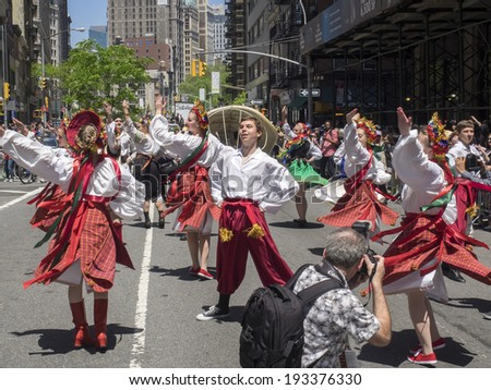 New York, NY, USA - May 17, 2014: Members of Iskra Ukranian Dance Ensemble march at The 8th Annual New York City Dance Parade and Festival