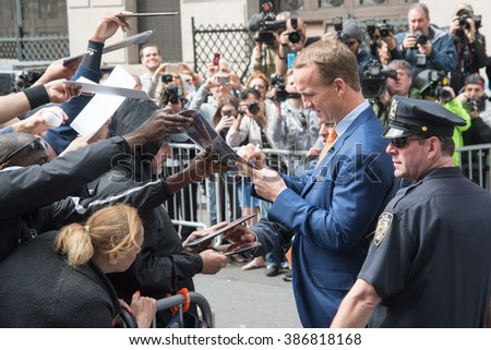 New York, NY / USA - May 20, 2015: Peyton Manning signs autographs for fans outside of the Ed Sullivan Theater during taping of the final episode of Late Night With David Letterman. - stock photo