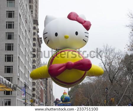 New York, NY USA - November 27, 2014: Hello Kitty balloon is flown at the 88th Annual Macy's Thanksgiving Day Parade along Columbus Circle - stock photo