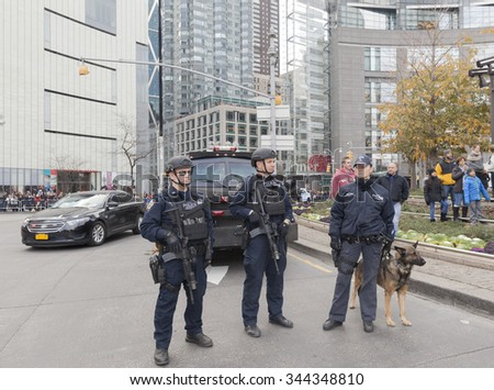 New York, NY USA - November 26, 2015: Members of NYPD emergency unit at the 89th Annual Macy's Thanksgiving Day Parade on Columbus Circle - stock photo