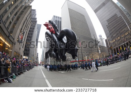 New York, NY USA - November 27, 2014: Toothless of How to Train your Daragon balloon is flown at the 88th Annual Macy's Thanksgiving Day Parade along 6th avenue