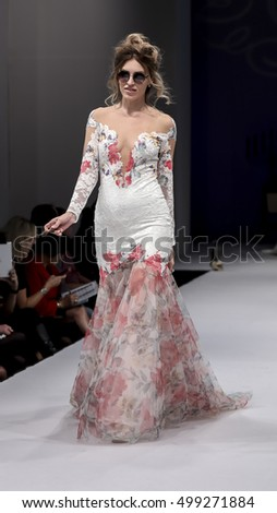 New York, NY, USA - October 8, 2016: A model walks runway for Olvi's by Olga Yermoloff Spring 2017 Collection 'Alchemy' during New York International Bridal Week at the Fashion Theater, Pier 94