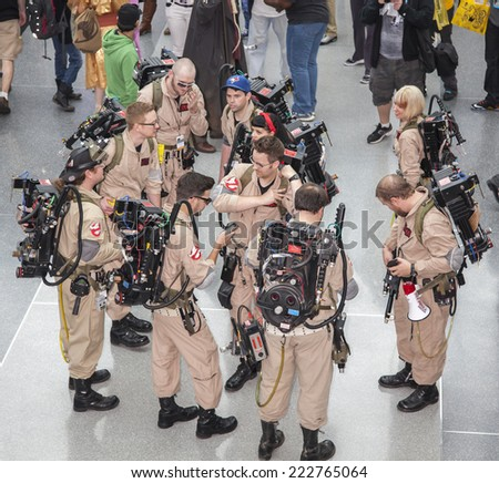 New York, NY, USA - October 10 2014: Group of Comic Con attendees in the costumes of ghostbusters during Comic Con 2014 at The Jacob K. Javits Convention Center in New York City - stock photo
