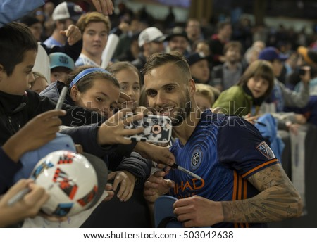 New York, NY USA - October 23, 2016: Maxime Chanot poses for selfie with young fans after last regular season MLS game between NYC FC & Columbus Crew SC NYC FC won 4 - 1