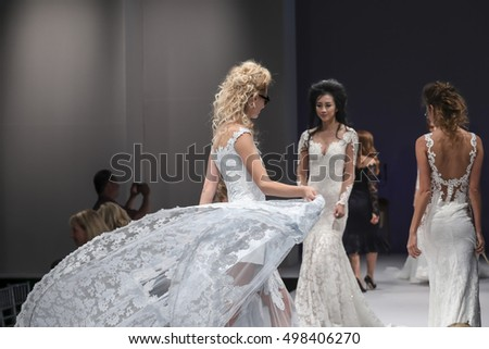 New York, NY, USA - October 8, 2016: Models walk runway for Olvi's by Olga Yermoloff Spring 2017 Collection 'Alchemy' during New York International Bridal Week at the Fashion Theater, Pier 94