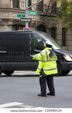 NEW YORK, NY, USA - OCTOBER 31: NYPD officers regulate traffic manually at intersections in the blacked-out zone of Manhattan after Hurricane Sandy in New York, NY, USA, on October 31, 2012. - stock photo