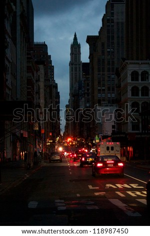NEW YORK, NY, USA - OCTOBER 31: Uncommon darkness has settled on the eerily empty, blacked-out streets of Lower Manhattan in New York, NY, USA, on October 31, 2012. - stock photo