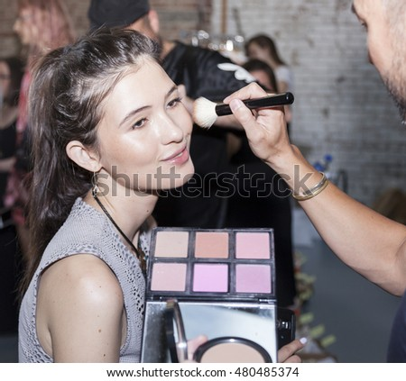 New York, NY, USA - September 7, 2016: A model prepares backstage for the WHIT Spring/Summer 2017 collection presentation during New York Fashion Week SS 2017 at The New York Academy of Art