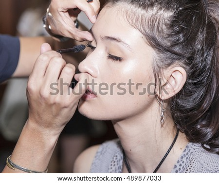 New York, NY, USA - September 7, 2016: A model prepares backstage for the WHIT Spring?Summer 2017 collection presentation during New York Fashion Week SS 2017 at The New York Academy of Art