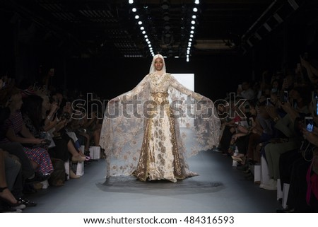 New York, NY USA - September 12, 2016: Model walks runway for Anniesa Hasibuan collection during New York Fashion week at Moynihan station