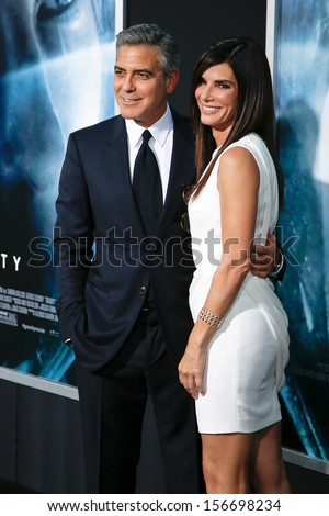 NEW YORK-OCT 1: Actors Sandra Bullock and George Clooney attend the 'Gravity' premiere at AMC Lincoln Square Theater on October 1, 2013 in New York City. - stock photo