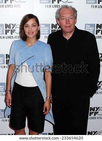 NEW YORK-OCT 5: Actress Marion Cotillard (L) and producer Luc Dardenne attend the 'Two Days, One Night' premiere at the New York Film Festival at Alice Tully Hall on October 5, 2014 in New York City. - stock photo