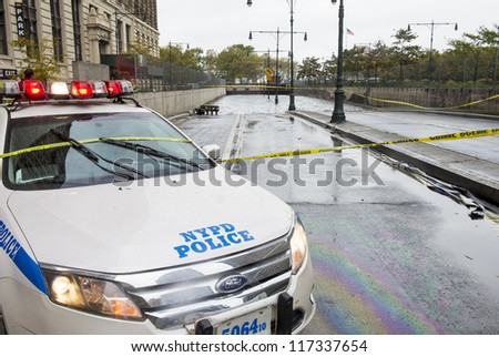 NEW YORK - OCT 30 :  Flooded road at downtown Manhattan as Hurricane Sandy aftermath  in October 30 2012 in New York. - stock photo