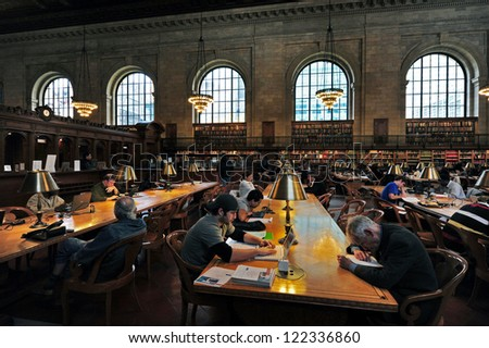 NEW YORK- OCT 14 2009: People reads books at the New York Public Library in Manhattan, New York City. With nearly 53 million items, It is the fourth largest public library in the world. - stock photo
